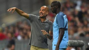 Guardiola y Yaya Touré, durante un partido.
